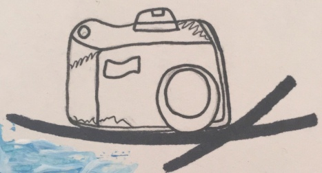 Camera in black pen.